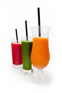 Glass orange, green and red smoothie